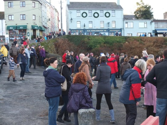Crowds on the pier at Roundstone after the burying of the time capsule.